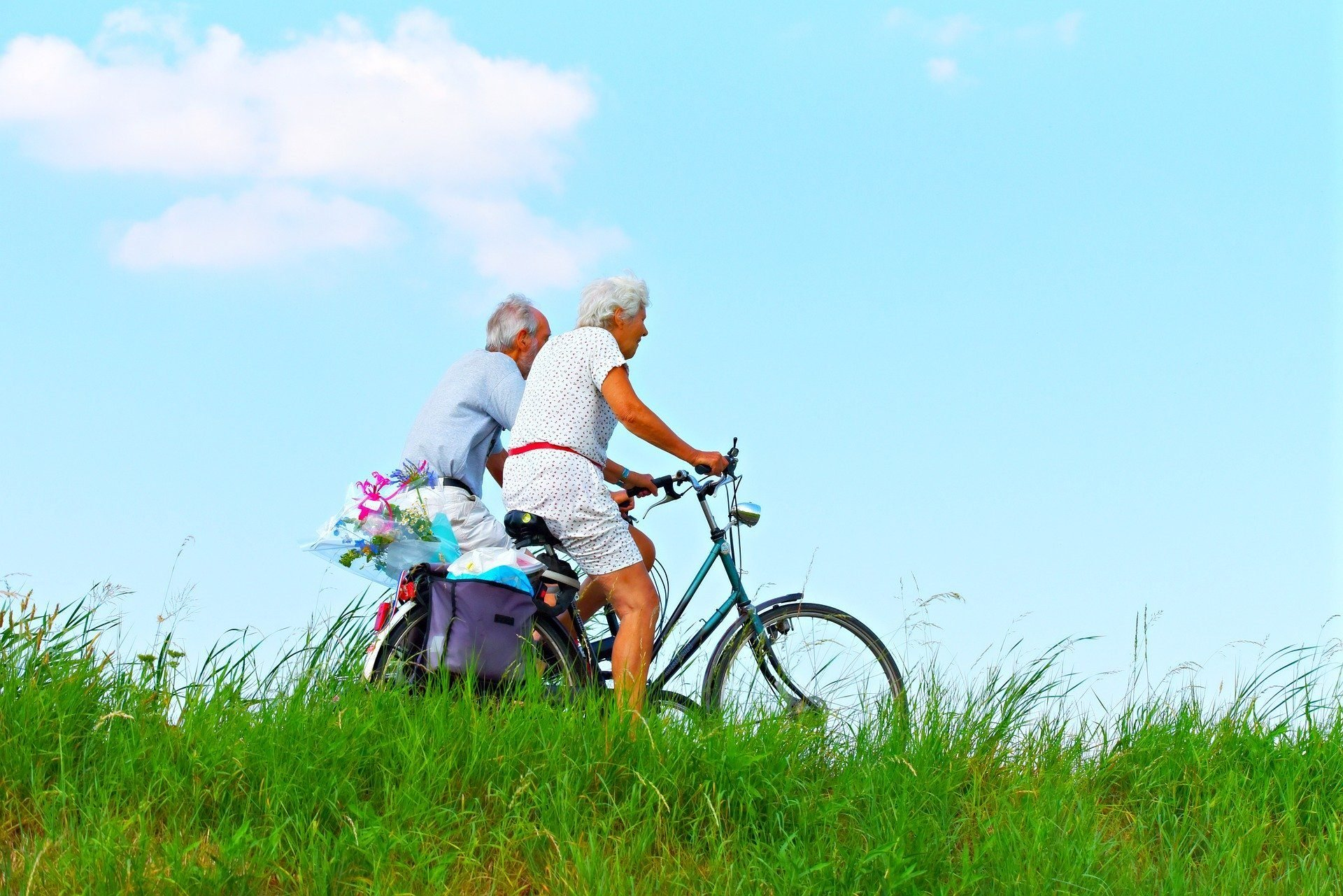 elderly people on a bicycle