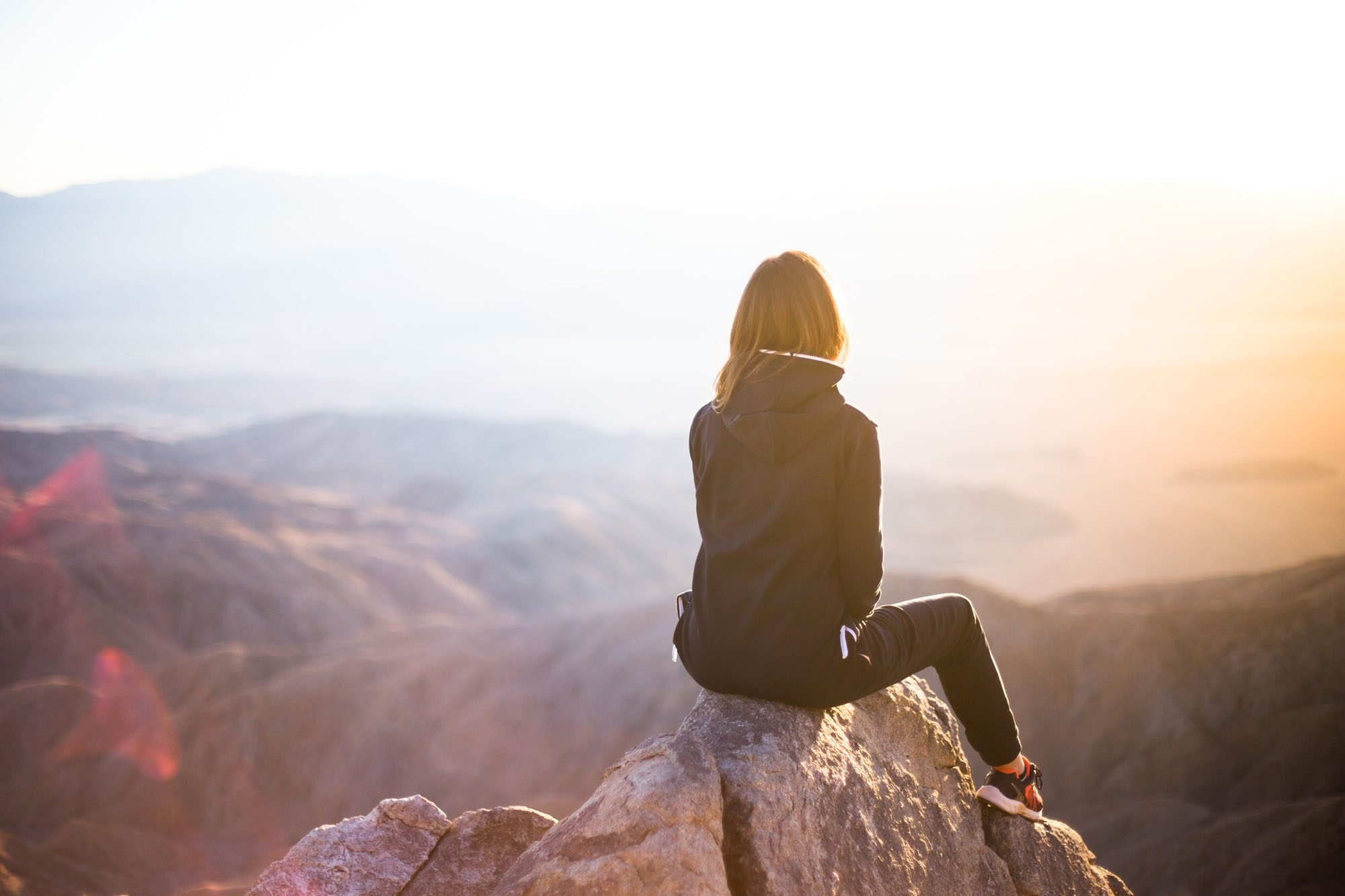 Girl sitting on a mountain